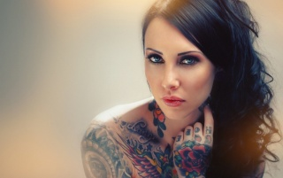 Gorgeous Blue Eyed Tattooed Brunette wallpapers and stock photos