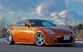 Nissan 350Z orange wallpapers and stock photos