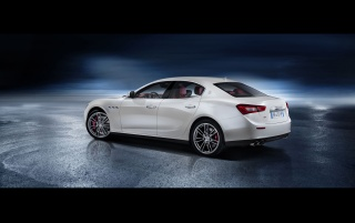 2013 Maserati Ghibli Static Rear Angle wallpapers and stock photos
