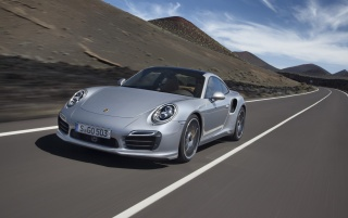Previous: 2013 Porsche 911 Turbo Motion Front Angle
