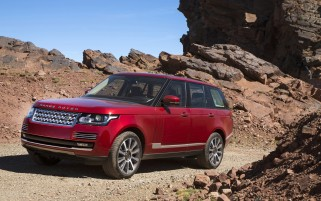 2013 Land Rover Range Rover in Morocco Red Rocks wallpapers and stock photos