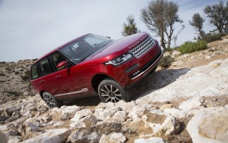 2013 Land Rover Range Rover in Morocco Red Rocks Side Angle wallpapers and stock photos