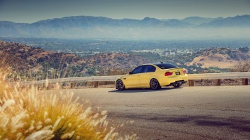 Yellow BMW M3 E90 Mountain Road wallpapers and stock photos