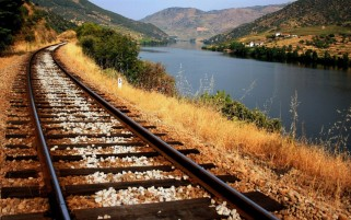 Train Tracks Along The River wallpapers and stock photos