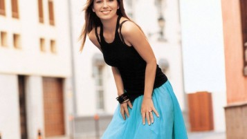 Pretty Girl in Turquoise Skirt wallpapers and stock photos