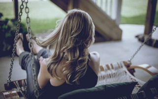Blonde Girl Rocking on the Porch wallpapers and stock photos