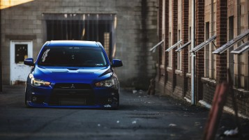 Blue Mitsubishi Lancer Evolution X wallpapers and stock photos