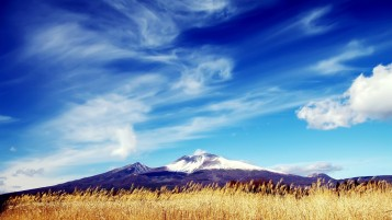Purple Mountains Behind Field wallpapers and stock photos