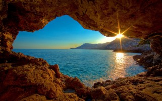 Sunrise Ocean Cave wallpapers and stock photos