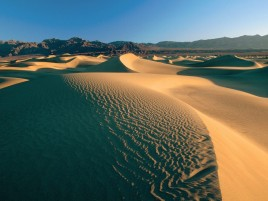 Desert Dunes Mountains & Sky wallpapers and stock photos