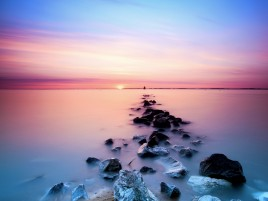 Pink Sky Ocean & Black Rocks wallpapers and stock photos