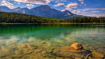 Mountains Forest Lake Stones wallpapers and stock photos