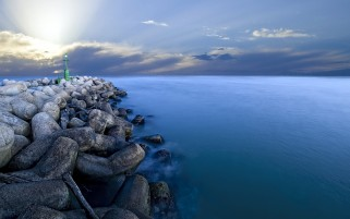 Sky Amplia Ocean & Stone Wall wallpapers and stock photos