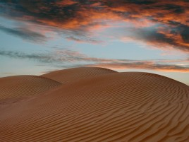 Desert Sand Dunes Red Clouds wallpapers and stock photos