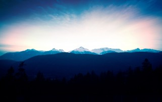 Mountains Horizon & Dark Trees wallpapers and stock photos