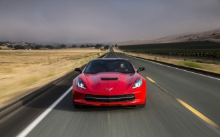 2014 Chevrolet Corvette Stingray Red Vorder Bewegung wallpapers and stock photos