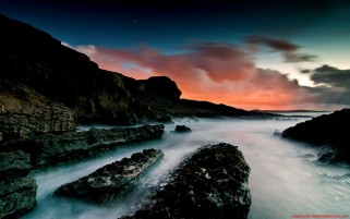 Ocean Black Rocks & Red Sky wallpapers and stock photos