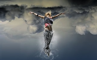 Woman Dancing in the Clouds wallpapers and stock photos