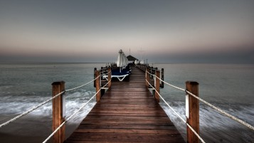 Grey Ocean Calm Jetty Cot wallpapers and stock photos