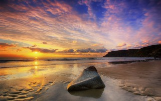 Sunset Ocean Beach Stone Cliff wallpapers and stock photos