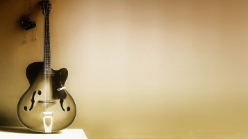 Acoustic Guitar on Wall wallpapers and stock photos
