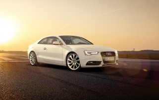 White Audi A5 Coupe Side Angle wallpapers and stock photos