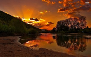 River Bank Sunset wallpapers and stock photos