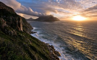 Beautiful Cliff Ocean Sunshine wallpapers and stock photos
