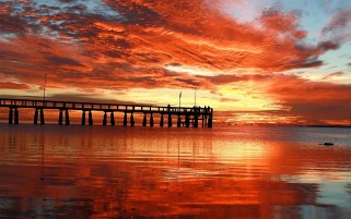 Fire Red Sunset Ocean Pier wallpapers and stock photos