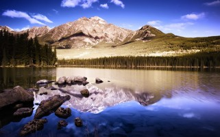 Mountains Trees Lake Stones wallpapers and stock photos