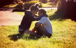 Young Couple in the Grass wallpapers and stock photos