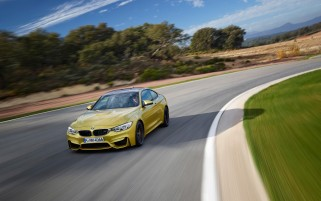 2014 BMW M4 Coupe Motion Front Angle wallpapers and stock photos