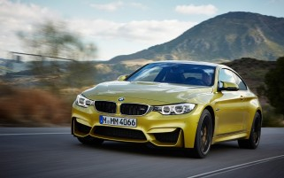 2014 BMW M4 Coupe Motion Front wallpapers and stock photos