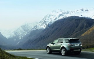 2015 Land Rover Discovery Sport Motion Rear Angle wallpapers and stock photos