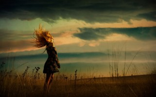 Windy Day Woman & Field wallpapers and stock photos