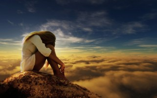 Sad Woman Mountain & Clouds wallpapers and stock photos