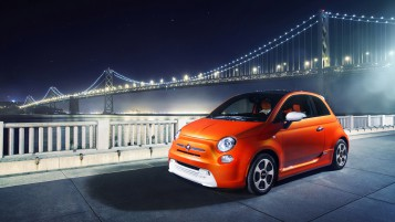 Orange Fiat 500 Side Angle wallpapers and stock photos