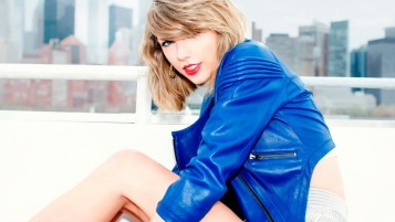 Random: Taylor Swift Wearing a Blue Leather Jacket