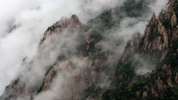 Misty Huangshan Mountain China wallpapers and stock photos