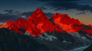 Red Sunset Over Mountains wallpapers and stock photos