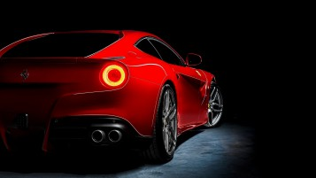 Red Ferrari F12 Berlinetta Rear Angle wallpapers and stock photos