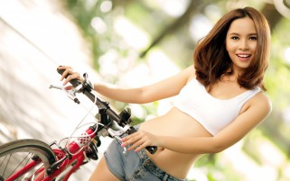 Muchacha con la bicicleta wallpapers and stock photos