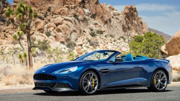 Blue Aston Martin Vanquish Roc wallpapers and stock photos