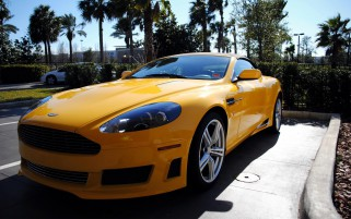 Yellow Aston Martin Vantage wallpapers and stock photos
