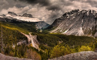 Road Between Mountains Snow Cl wallpapers and stock photos