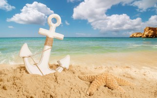 Anchor On The Beach wallpapers and stock photos