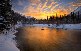 Calm River Sunset Forest Snowy wallpapers and stock photos