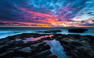 Ocean Black Rocks & Pink Sky wallpapers and stock photos