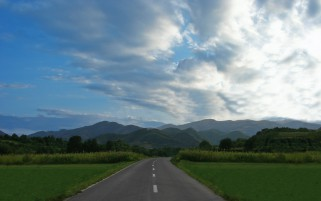 Mountains Field Road Grass Sky wallpapers and stock photos