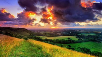 Dark Sunset & Green Hills wallpapers and stock photos
